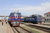 Kherson (L-R) - UZ TEP70-0031 waits to depart with 375 1530 Kherson - Kharkiv while UZ TEP70-0156 waits to depart with 765 1557 Kherson - Kyiv Pas; the latter would overtake the former at Mykolaiv, which it's booked to do