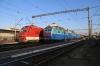 UZ ChS8-024 waits to depart Kyiv Pas with 081K 1830 Kyiv Pas - Uzhhorod while UZ DS3-011 runs through the station