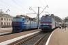 UZ VL40U-1457-1 waits to depart Lviv with 110 1539 Lviv - Kherson while UZ ChS7-123 is detached from 042L 1236 Truskavets - Dnipropetrovsk Holovnyi adjacent