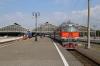RZD TEP70-0388 waits to depart Kaliningrad Pas. with 080 1028 Kaliningrad Pas. - St Petersburg Vitebski; RZD's TEM18D-001 waits in the adjacent platform