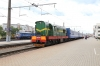 BCh ChME3-3910 at Orsha having shunted a through Brest - Murmansk  coach from the sidings onto 066B 1021 Minsk - Murmansk. the coach had been shunted off 658B 2029 (P) Brest - Vitebsk 4 hours earlier by ChME3-3747. 2M62U-0260B is stabled in the adjacent yard