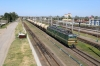 BCh VL80S-581 runs through Zlobin with a freight while ChME3-4090 waits its next work