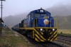 Peru Rail MLW DL560 #659 leads train 20 0800 Cusco Wanchaq - Puno as it stands at the summit of La Raya at 4319m