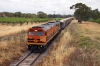 "GWA Goodwin/MLW DL500G 700 Class, 704 leads Goodwin Alco DL531 830 Class, 841, through Jacobs Creek towards Altona under the Barossa Valley Way with ""The Stonie"" from Penrice Soda Holdings to Osborne"