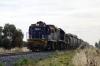 PN Goodwin/Alco DL531 48 Classes, 48163 & 48162 sandwich Clyde/EMD G26C X Class, X46 as they run between Yarrabandai & Bogan Gate with 8832 Condobolin - Manildra loaded grain