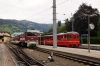 SLB Vs 82 prepares to depart Zell am See with 3322 1600 Zell am See - Krimml while a heritage EMU departs on a chartered service