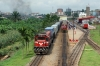 CamRail GM GT26CU-3 CC3301 sits at Yaounde with a container train while Grindrod Pembani Remgro (GPR Leasing Africa) GM GL30SCC-3 GPR30-07 arrives with IC151 0600 Douala - Yaounde Intercity