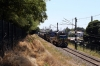 Temuco, Chile - FEPASA GM SD39-2's 2355/2360 head away from Temuco yard with a southbound freight as they cross Andres Bello foot-crossing