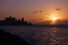 View down Malecon towards the Hotel Nacional (in the distance), Havana, as the sun sets over the Straits of Florida