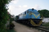 FCC MLW MX624 52407 runs through the Pinar Del Rio suburbs with 179 1830 Pinar Del Rio - Guane