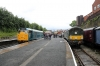 31162 waits time at Bury with the 0943 Rawtenstall - Heywood, with Co-Bo D5705 standing on display beside it