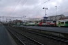 VR Sr1's 3021/3084 pass through Tampere with a freight while classmate Sr1 3054 sits with a rake of stock