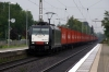 185471 runs through Sarstedt with a container train