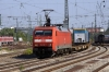 DB 152150 runs through Munich Ost with a container train