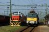 MAV 431143 arrives into Szekesfehervar with 9067 0830 Veszprem - Budapest Deli; MAV 478327 stands alongside