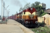 VSKP WDG3A's 14879/13210 power through Sambalpur Road with a freight