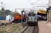 MGS WAG7 27071 waits at Jharsuguda Jn with 58111 0630 Tatanagar - Itwari Jn while KGP WDG3A's 13547/13353 refuel with a freight behind