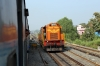 BNDM WDM3D 11412 eases 18005 2130 (P) Howrah - Jagdalpur into Sambalpur Jn; BNDM WDG3A 13422 waits outside the station to drop onto the rear and shunt the Sambalpur portion off the train