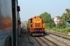 BNDM WDM3D 11412 eases 18005 2130 (P) Howrah - Jagdalpur into Sambalpur Jn; BNDM WDG3A 13422 waits outside the station to drop onto the rear and shunt the Sambalpur portion off the train