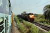 VSKP WDG3A's 13651/13534 approach Singapuram Road with a freight