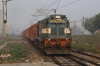 CLA WDG3A 14679 runs through Shahjahanpur Jn with a freight