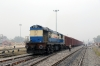 NGC WDG3A 14839 shunts a train together at Saharsa Jn; after its wagon loads of rice have been offloaded