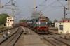 ET WDM3A/D twins 14101/11381 run through Raipur Jn with a northbound freight