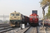 KTE WDG3A 14643 waits the road north at Marwar Jn with a double-stack container train while BGKT WDG4 12198 waits alongside with a conventional freight