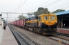 KYN WDG4D 70327 passes through Lingampalli with a freight