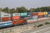 ABR WDM3A 14121 arrives into Marwar Jn with a southbound double-stack container train while LDH WDG3A 13321 sits in the station with an observation coach