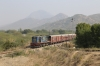 FL YDM4 6732 passes by Phulad's home signal, on the Mavli Jn branch, with 52076 0700 Mavli Jn - Marwar Jn, after the pointsman had set the road into the station