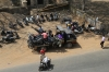 Confiscated mopeds & motorbikes are lined up near Sabarmati Town station