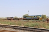 SBI YDM4's 6666 & 6557 on BG flat wagons in the yard adjacent to Sabarmati Town station, having completed its journey from IZN, via a Marwar Jn stop-over