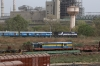 ABR WDM3A 14117 departs Sabarmati Jn with 19412 0625 Ajmer Jn - Ahmedabad Jn. Stabled in the yard adjacent to Sabarmati Town is SBI YDM4 6557 on a BG flat wagon (6666 is out of sight)