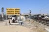 KJM WDM3D 11521 waits to depart Ahmedabad Jn with 16588 2210 (P) Bikaner Jn - Yesvantpur Jn, BRC WAP5 30056 waits in an adjacent platform with 19036 1420 Ahmedabad Jn - Vadodara Jn