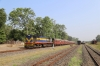 VRL outbased SBI YDM4 6560 waits departure from Talala Jn with 52950 0745 Delvada - Veraval Jn while 6563 waits to run-round having just arrived with 52952 0715 Junagadh Jn - Delvada