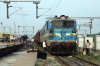 NKJ WAG7 27664 stands at Khurda Road Jn with a goods train