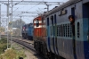 KTE WDG3A 14952 at Kashi with 13009 2035 (06/03) Howrah - Dehradun; IZN WDM3D 11300 shunts coal wagons for unloading ahead
