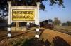 GD WDM2 16887 waits departure from Barhaj Bazar with 55106 0650 Barhaj Bazar - Salempur Jct passenger
