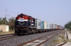 RTM WDM3A 18705 runs through Ambli Road with a container train