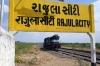 RTM WDM3A 16811 runs round at Rajula City to work 59243 1205 Rajula City - Mahuva; the only train of the day to depart Rajula City