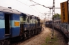 KJM WDG3A 13043 runs parallel to 12252 0800 (P) Korba - Yesvantpur, headed by KJM WDM3D's 11522/11520, as it runs an empty stock into Yesvantpur Jn