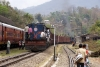 LMG YDM4s 6714/6642 lead a northbound freight away from Mahur, 6354 is banking on the rear, also loaded with people!