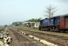 LMG YDM4 6639 waits at Arunachal Jct with 15694 0825 Silchar - Lumding Jct