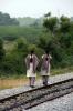 Local girls walk down the rail head at Chamarajanagar, Karnataka