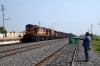 WDG3A's 14889/13447 pass through Tarigopulla with a goods train