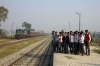 College students pose at Dohna as IZN YDM4 6686 arrives with 52208 0715 Pilibhit Jct - Izatnagar
