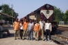 Gurra, Madhya Pradesh - track gang posing in front of KTE WDM2 17665; which stands waiting a loco pilot to continue dropping rails in the area