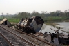 The remains of WDM3A crash victims, UDL 16411 & BWN 16089, lay strewn at the side of the tracks at Gour Malda, surrounded by various bits of wheels and wagon