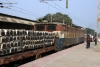 WAG7 27501 at Dildarnagar Jct with a train full of sleepers, loaded neatly yet not strapped to the wagons
